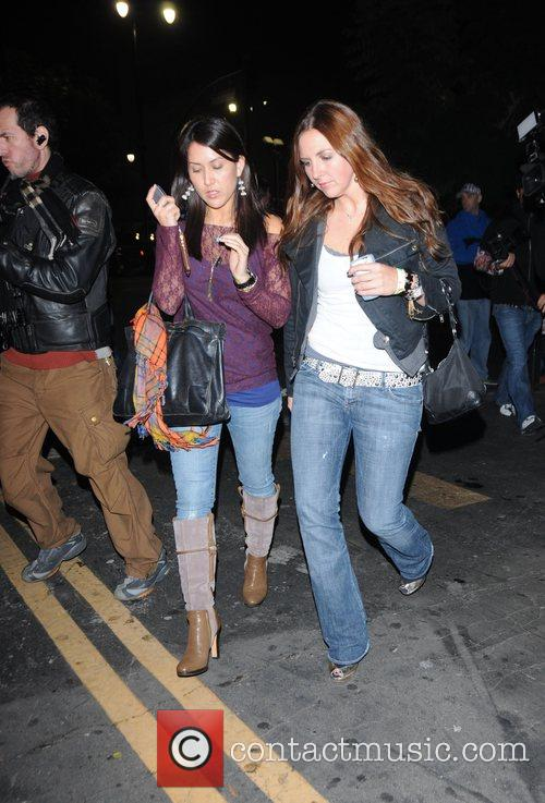 Alli Simms walking with a friend on Hollywood...
