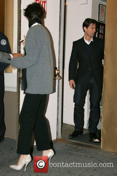 Katie Holmes leaving with Tom Cruise after performing...