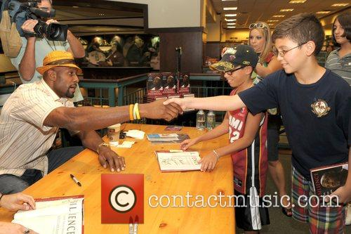 Alonzo Mourning NBA champion signs copies of his...
