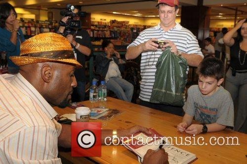 NBA champion signs copies of his new book...