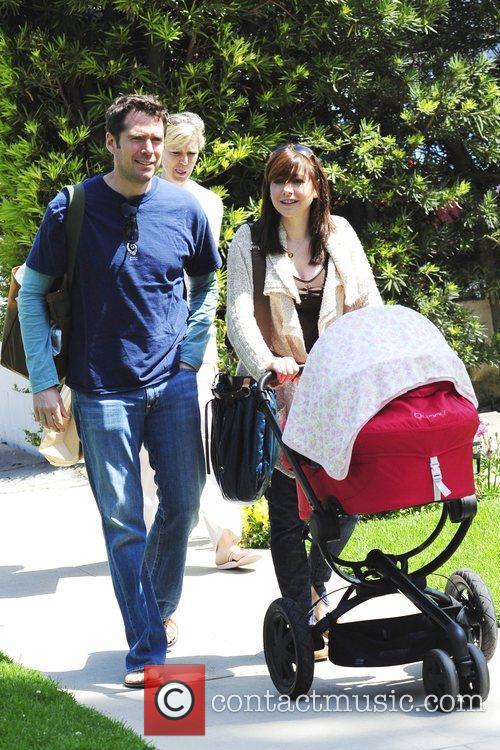 Alyson Hannigan pushing her seven week old baby,...