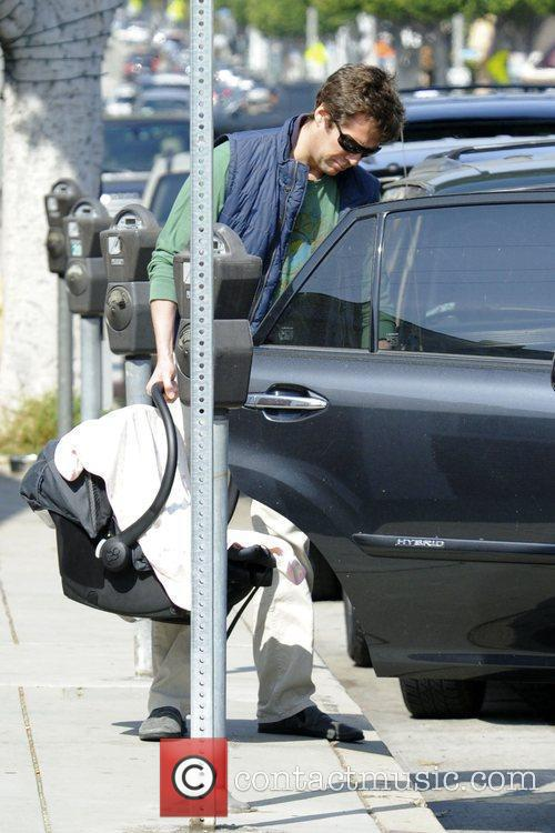 Alexis Denisof returns to his car after shopping...