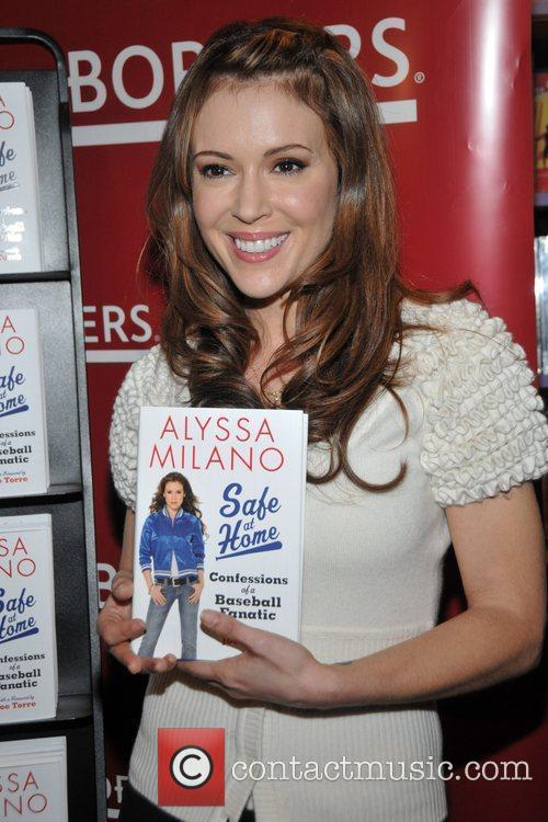 Actress Alyssa Milano signs copies of her new...
