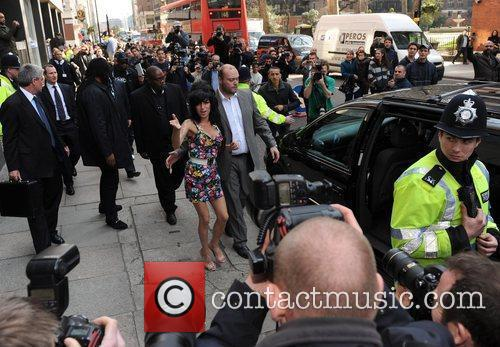 * WINEHOUSE DENIES ASSAULT CHARGE Troubled singer AMY...