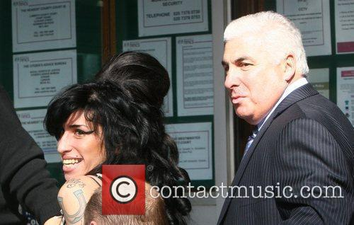 Amy Winehouse and Mitch Winehouse arrive for her...