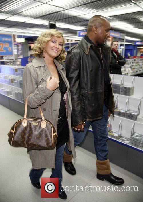 Anastacia  shopping at Saturn consumer electronics store...