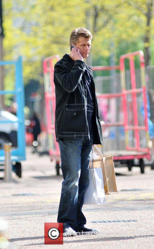 Andrew Castle Chats on his mobile phone as...