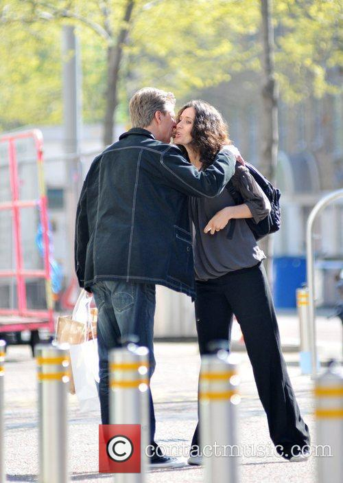 Andrew Castle greets a female friend with a...
