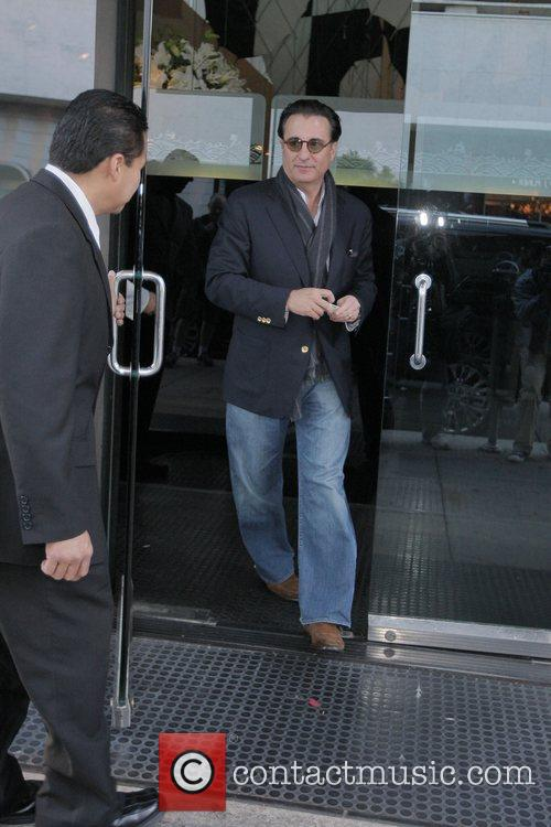 Andy Garcia tips the doorman $10 dollars as...