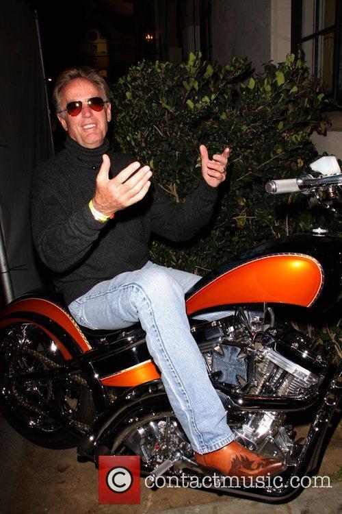 Peter Fonda poses on a Harley Davidson Motor...