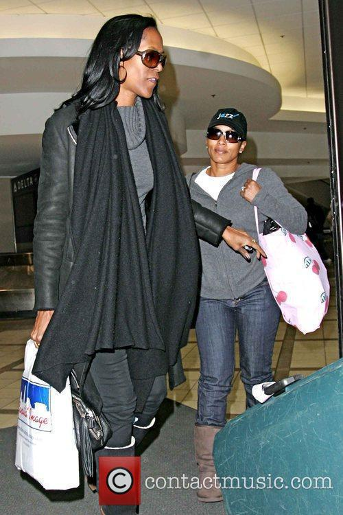 Arrives at LAX airport after returning from the...