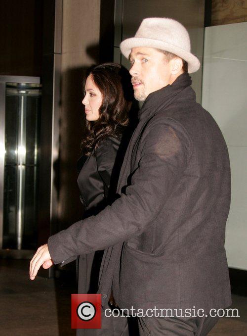 Angelina Jolie and Brad Pitt leaving the Nobu...