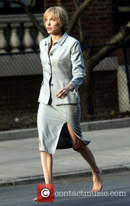 Angelina Jolie running barefoot with a bloody knee...