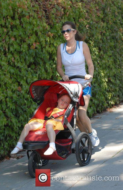Out jogging with her daughter Gracie and a...
