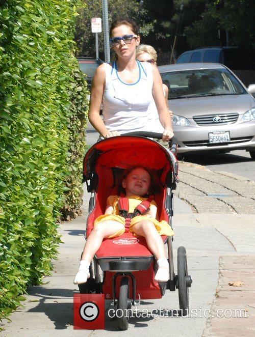 Anna Friel out jogging with her daughter Gracie...