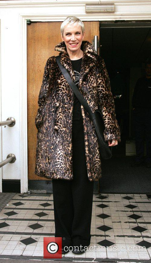 Annie Lennox is all smiles as she leaves...