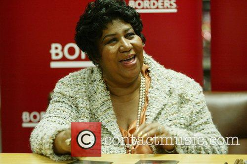 Aretha Franklin signs copies of her first Christmas...