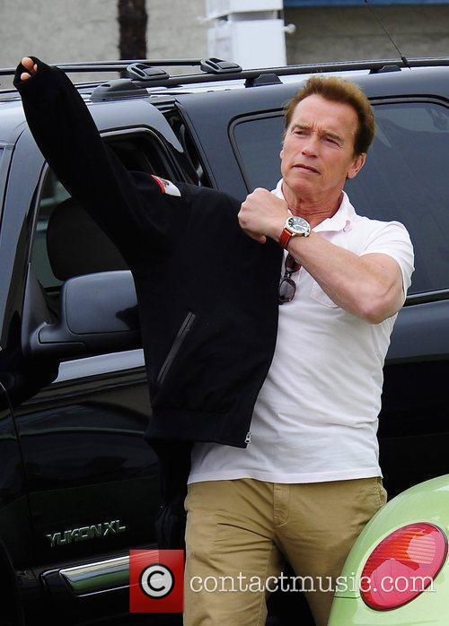 Arnold Schwarzenegger leaving a restaurant after having lunch...