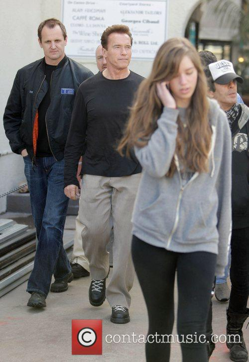 Arnold Schwarzenegger and his daughter Christina leaving Cafe...
