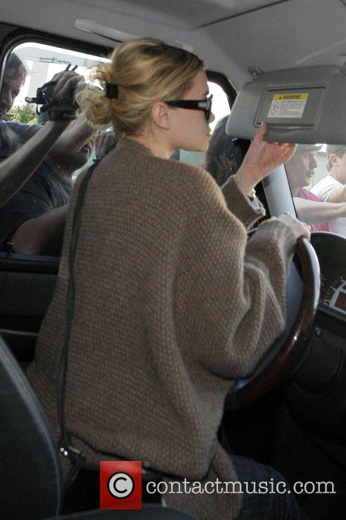 Ashley Olsen is met with a frenzy of...