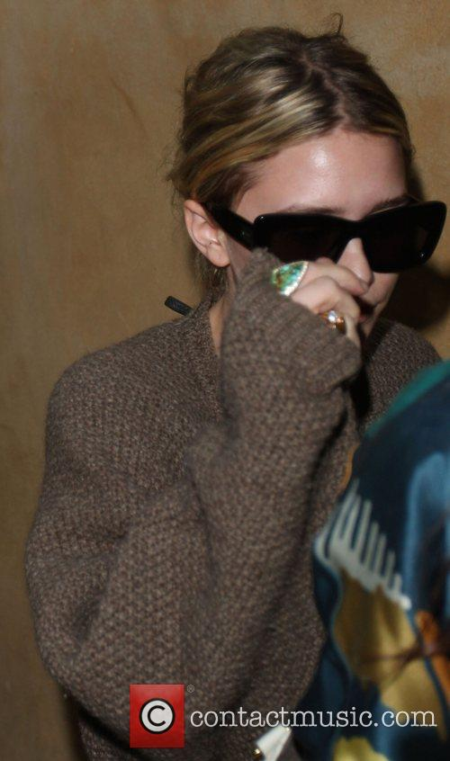 Ashley Olsen is greeted with a frenzy of...