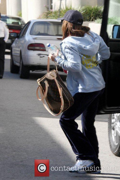 Ashley Tisdale outside her gym while wearing a...