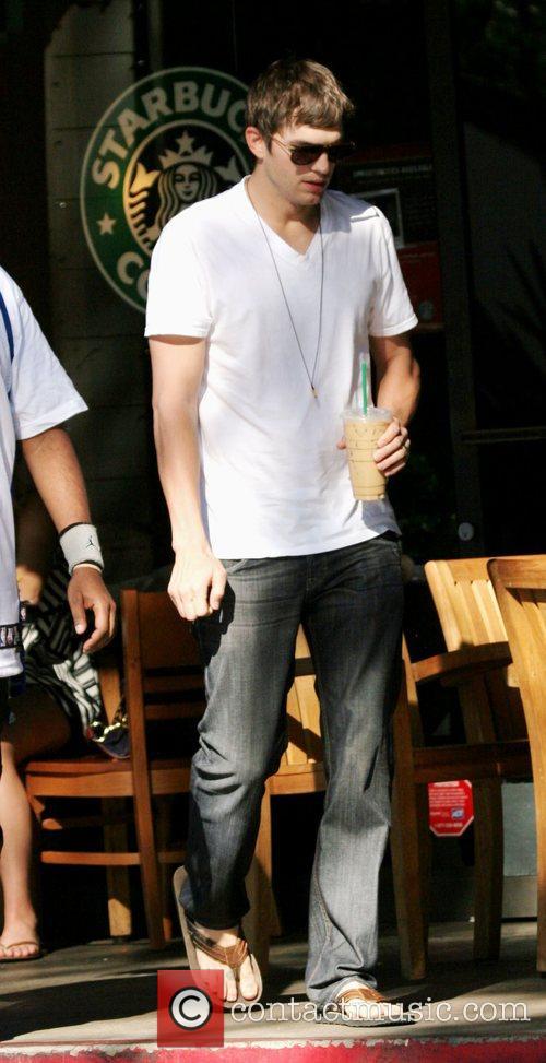 Ashton Kutcher stops by Starbucks coffee in Beverly...