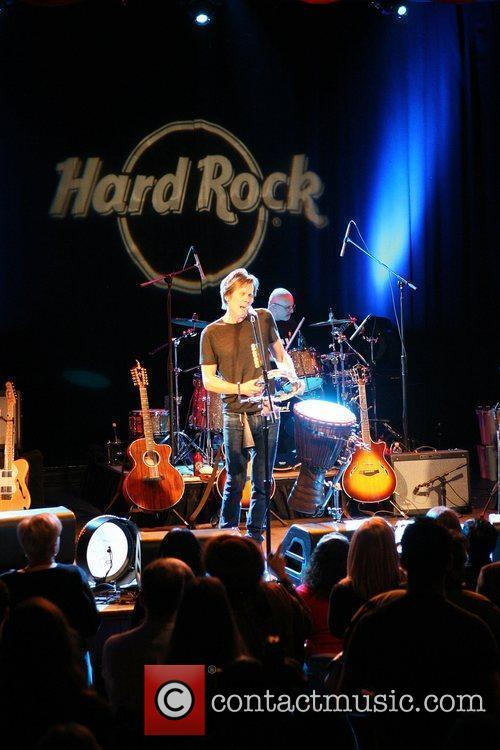Performing live at the Hard Rock Cafe in...