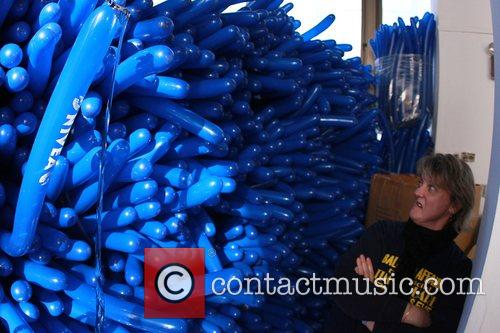 Volunteers inflate tens of thousands of New Year's...