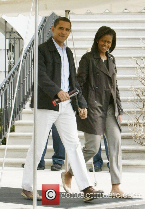 Barack Obama and Michelle Obama leaving the White...