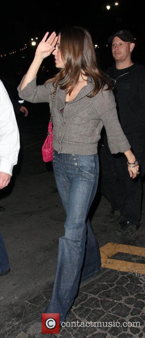 Eliza Dushku tries to hide her face from...