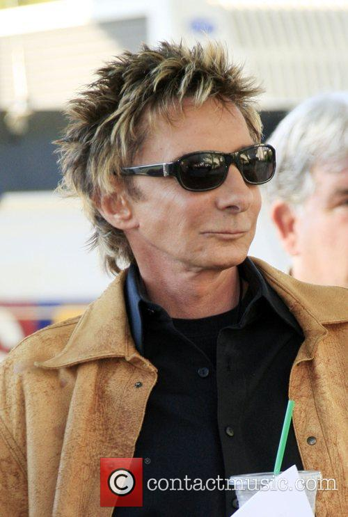 Barry Manilow goes for an iced coffee in...