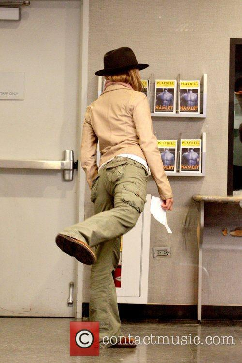 Jennifer Aniston  balancing on one foot while...