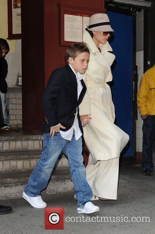 Brooklyn Beckham and Victoria Beckham arrive at the...