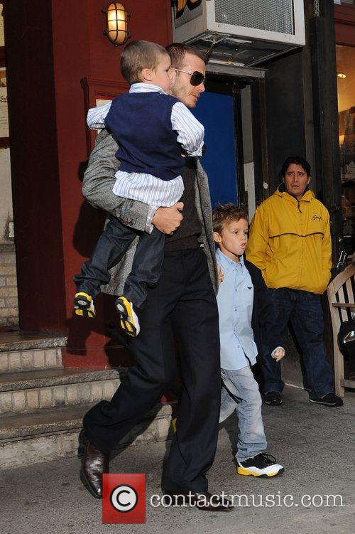 David Beckham with sons Cruz Beckham and Romeo...