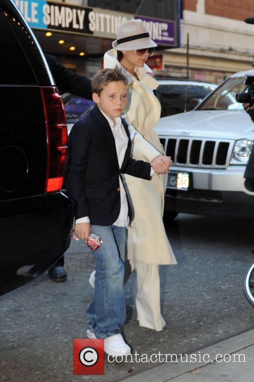 Victoria Beckham and son Brooklyn Beckham arrive at...