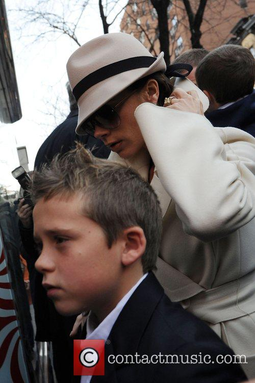 Victoria Beckham and son Brooklyn Beckham arrive at...