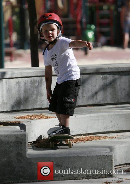 Cruz Beckham playing with a skateboard at Coldwater...