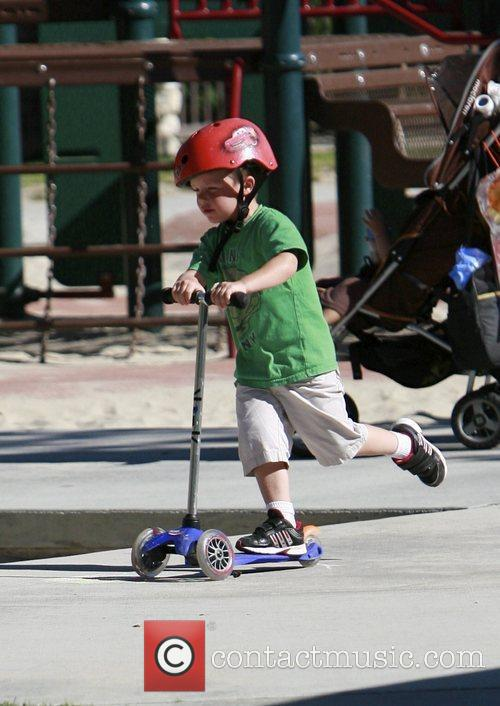 Cruz Beckham playing on his scooter at Coldwater...
