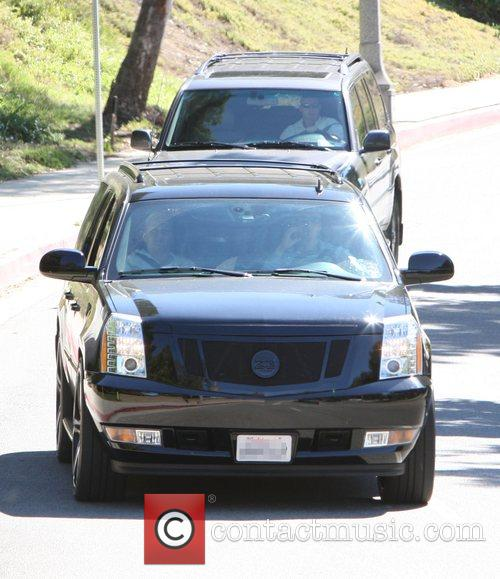 The Beckham children are collected from school in...