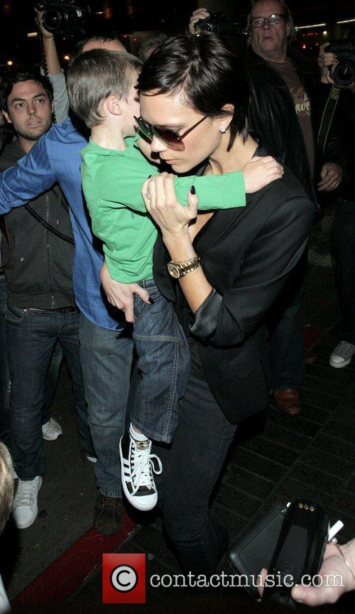 Victoria Beckham and son Cruz arrive at LAX...