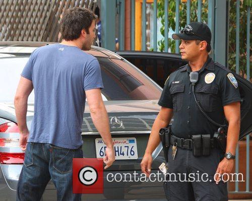 Ben Affleck gets a police escort as he...