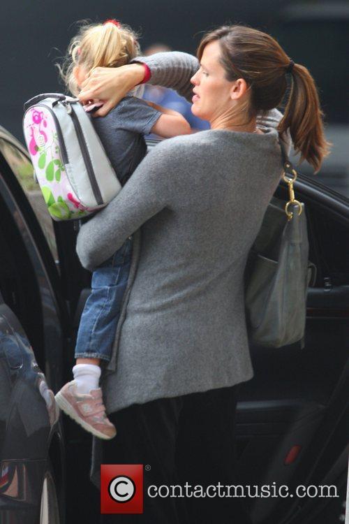 Jennifer Garner gets a police escort as she...