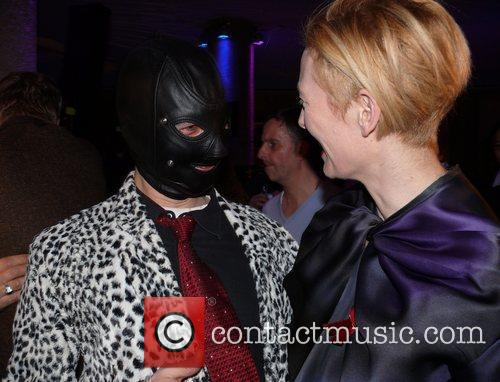 Tilda Swinton and Masked Man 1