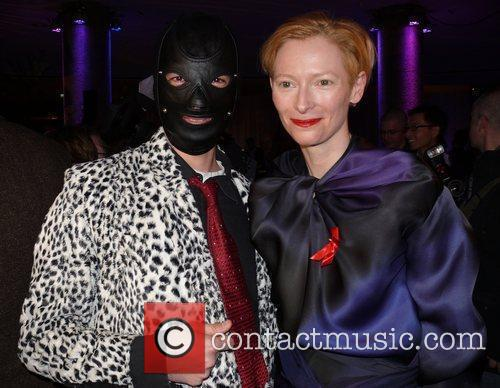 Tilda Swinton and Masked Man 5