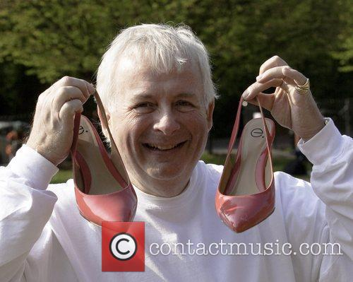 Wears ladies' high-heeled shoes to compete in a...