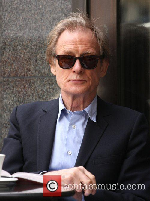 Bill Nighy enjoys a book and a cup...