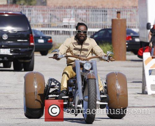 will.i.am riding a motortrike while on a video...