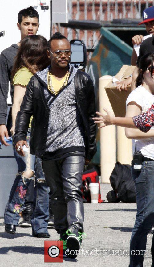 Apl.De.Ap at the Black Eyed Peas music video...