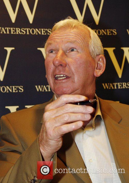 Former Arsenal goalkeeper Bob Wilson signing copies of...